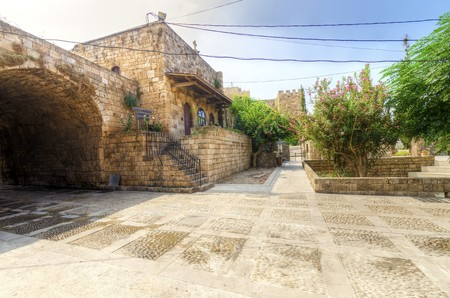 A view of the old pedestrian souk in Byblos, Lebanon during the day. A very medieval and picturesque area,  paved with little stones and with little shops. photo
