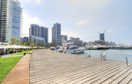 embarked: A view of the beautiful Marina in Zaitunay Bay in Beirut, Lebanon. A very modern, high end and newly developed area where yachts are embarked and its perfect for a waterfront promenade. Stock Photo