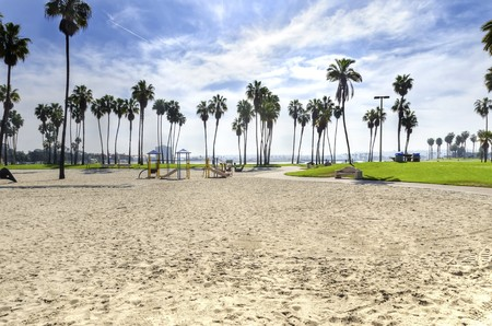 southern california: The Bonita cove park in southern Mission Bay over the Pacific beach in San Diego, California in the United States of America. A view of the golden sandy beach, palm trees, playground and clear sky.