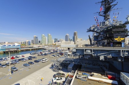 The historic aircraft carrier, USS Midway Museum moored in Broadway Pier in Downtown San Diego, Southern California, United States of America and the skyline  A battleship commissioned after the World War II