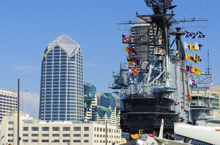 embarked: The historic aircraft carrier, USS Midway Museum moored in Broadway Pier in Downtown San Diego, Southern California, United States of America  A battleship commissioned after the World War II  Editorial