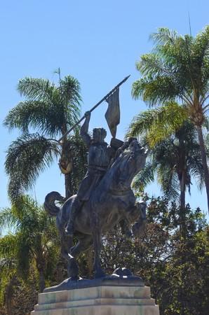 The statue of El Cid, Rodrigo Díaz de Vivar, a spanish medieval hero on a horse holding a spear and shield  The sculpture was a gift by Anna Hyatt in Balboa Park, San Diego, California in plaza de Panama photo