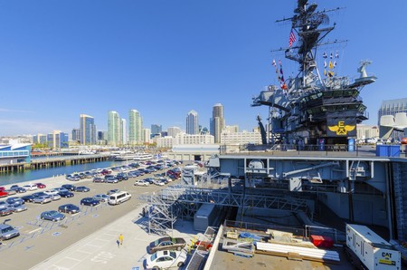 embarked: The historic aircraft carrier, USS Midway Museum moored in Broadway Pier in Downtown San Diego, Southern California, United States of America and the skyline  A battleship commissioned after the World War II