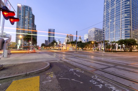 A street view of Downtown San Diego, California, USA, at dusk  A night view of the transportation, city lights and skyscrapers and local buildings in the Marina Stock Photo