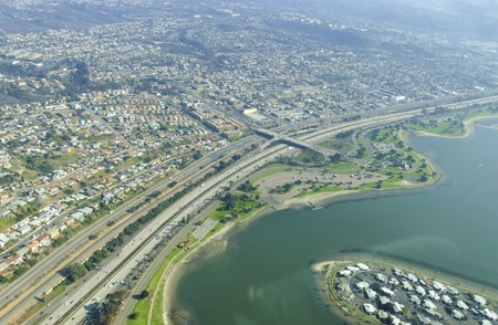 An aerial view of San Diego Mission Bay in southen California, United States of America. A view of the coastline, De Anza cove, Mission Bay park, San Diego Fwy and the local houses. photo