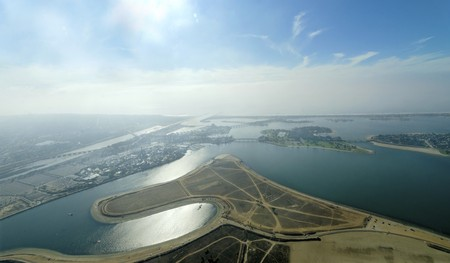 housing lot: An aerial view of San Diego Mission Bay in southen California, United States of America. A view of the coastline, the fiesta island Park opposite seaword, San Diego river and stony point