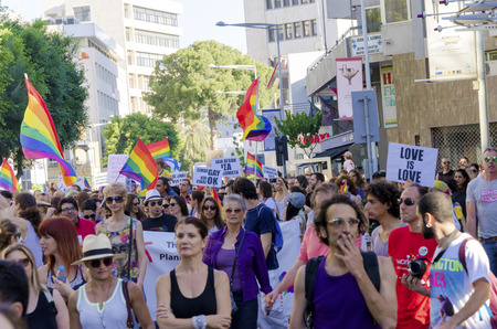 bisexual: NICOSIA, CYPRUS - 31 MAY 2014: The first Gay Pride Parade in Cyprus to celebrate LGBT, lesbian, gay, bisexual and transgender rights. Rainbow flags waving around and people marching for human rights.