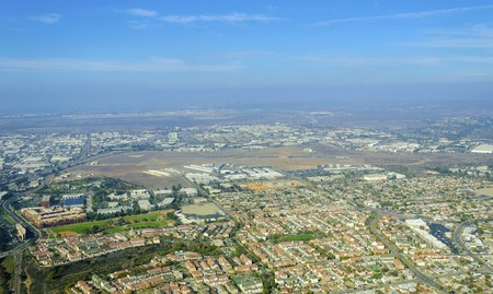 upscale: Aerial view of Mission Hills neighborhood and San Diego International Airport (Lindbergh Field), in Southern California, United States of America. An upscale affluent area in the city. Stock Photo