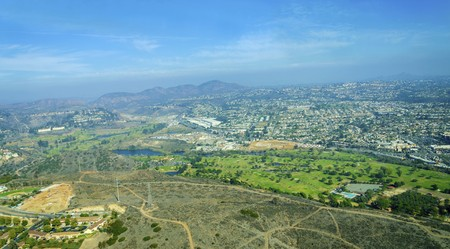 golf of california: Aerial view of Mission Valley neighborhood, San Diego in Southern California, United States of America. A wide river valley trending east-west in San Diego, through which the river flows to the Pacific Ocean. Stock Photo