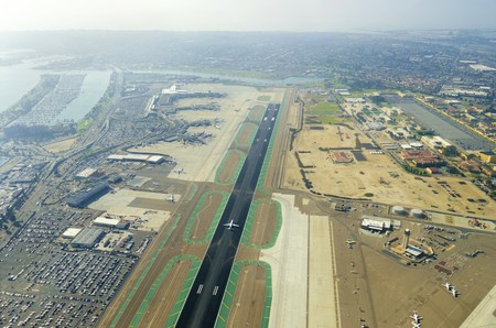 airport runway: Aerial view of the San Diego International Airport, river and pacific ocean, in Southern California. Lindbergh Field is the busiest single runway commercial airport in the United States of America.