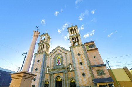 The Catedral de Nuestra Senora de Guadalupe, the first catholic church in Tijuana, Mexico of the Lady of Guadalupe. A view of the exterior of the cathedral, the arch, two towers, columns, clock and cross. Stock Photo