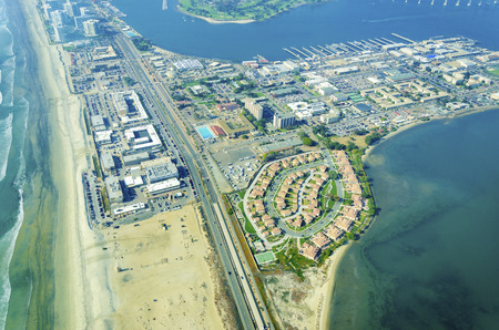 Aerial view of the Coronado island in the San Diego Bay, the silver strand and pacific ocean in Southern California, United States of America. A view of some local houses and architecture. photo