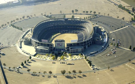 Aerial view of Qualcomm Stadium, San Diego in Southern California, United States of America and trolley line. A stadium used for concerts, the super bowl, football, baseball games and other sports.