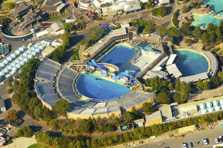 Aerial view of SeaWorld, a marine life theme park in San Diego Bay in Southern California, United States of America. A view of the killer whale shamu stadium and the show pools around.