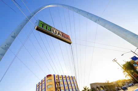 millennial: The Millennial Arch (Arco y Reloj Monumental), a metallic steel arch at the entrance of the city of Tijuana in Mexico, at zona centro a symbol of union and vigor to the new millennium and a landmark that welcomes tourists in Avenida de revolucion with a s Editorial