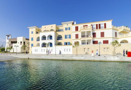 high end: The beautiful Marina in Limassol city in Cyprus. A very modern, high end and newly developed area where yachts are moored and its perfect for a waterfront promenade. A view of the residential area.