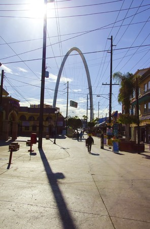 vigor: The Millennial Arch (Arco y Reloj Monumental), a metallic steel arch at the entrance of the city of Tijuana in Mexico, at zona centro a symbol of union and vigor to the new millennium and a landmark that welcomes tourists in Avenida de revolucion with a s Stock Photo
