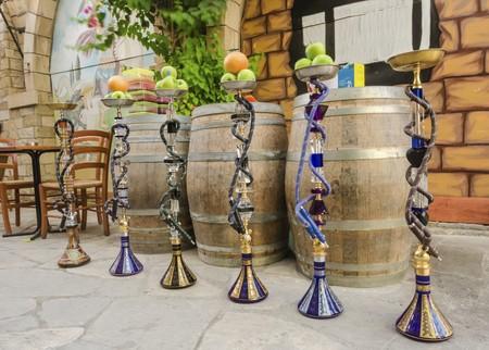 Six shisha, aka nargile or hookah at a restaurant with fruit on top. A very middle eastern custom. photo