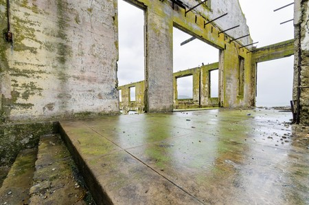 correctional officer: The Social Hall on Alcatraz island prison, now a museum in San Francisco, California, USA. A view of the stripped, burned, moldy walls and the ruins, a result of the native american occupation. Editorial