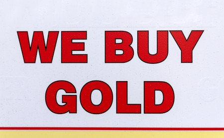 A sign that reads we buy gold. A means of exchanging golden items such as jewelry for cash as an investment.