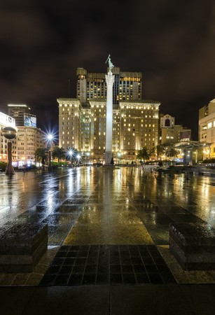 dewey: A night view of the Union Square in downtown San Francisco, California, United States. A landmark of the area with a column of a statue of Victory holding a trident on top in the heart of the city center.