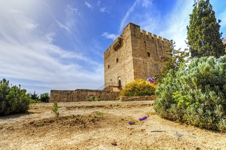 constitutes: The medieval castle of Kolossi. It is situated in the south of Cyprus, in Limassol. The castle dates back to the crusades and it constitutes a landmark of the area.