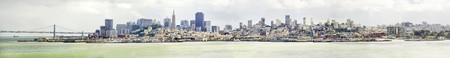 The San Francisco skyline in California, United states of America from Alcatraz island. A panoramic view of the cityscape, the skyscrapers, architecture, fishermans wharf and piers Transamerica pyramid and Bay Bridge.