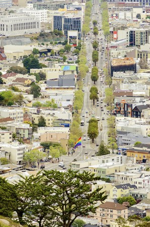 Aerial view of Market street in the Castro, San Francisco, California, United States of America. View of the avenue, LGBT rainbow flag waving, cityscape and Castro area from Twin Peaks.