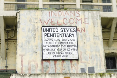 The old sign on Alcatraz Penitentiary island, now a museum, in San Francisco, California, USA, which was painted with red graffiti by Indians during the native American occupation. Editorial
