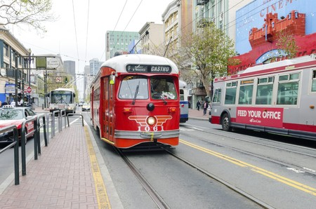castro: Market street in Downtown and South in San Francisco city, California, United States of America. A view of the MUNI bus leading to the Catro, the transport, shops, architecture, cable car lines and cityscape