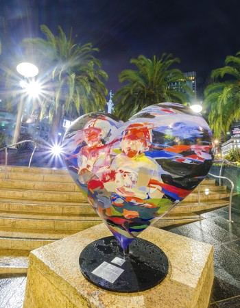 dewey: A night view of the art of painted heart sculpture in Union Square in downtown San Francisco, California, United States. Editorial