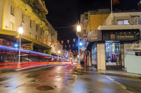 Night view of San Francisco Chinatown in northern California, United States of America. A view of the traditional red lamp lanterns hanging over the streets and Chinese signs over the shops. Editorial
