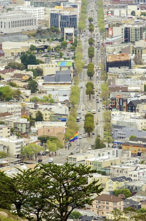 Aerial view of Market street in the Castro, San Francisco, California, United States of America. View of the avenue, LGBT rainbow flag waving, cityscape and Castro area from Twin Peaks. photo