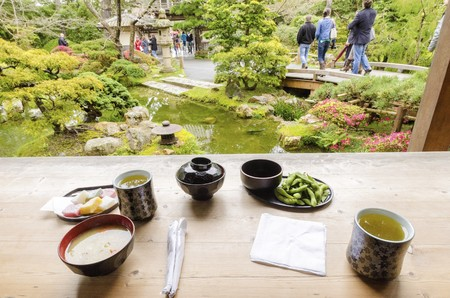 japanese tea garden: The Japanese Tea  Garden in Golden Gate Park in San Francisco, California, United States of America. A view of green tea, miso soup, sweets and edamame from the tea house next to a pond that create a relaxing scenery. Editorial