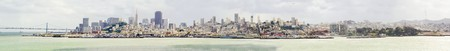 The San Francisco skyline in California, United states of America from Alcatraz island. A panoramic view of the cityscape, the skyscrapers, architecture, fishermans wharf and piers Transamerica pyramid and Bay Bridge. photo