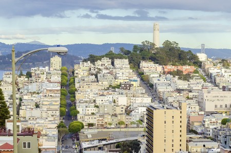coit: Coit Tower, aka the Lillian Coit Memorial Tower on Telegraph Hill neighborhood of San Francisco, California, United States of America. A view of the flutted white tower from Lombard street.