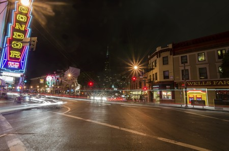 A night view of Little Italy at the intersection of Columbus and Broadway in North Beach, San Francisco, California, United States of America.