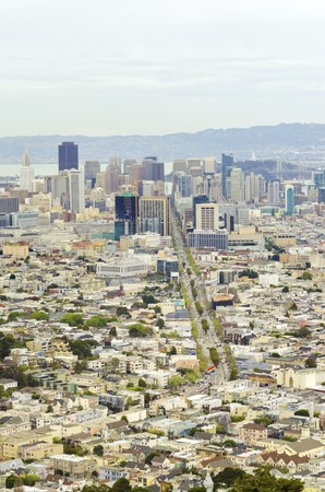 Aerial view of downtown San Francisco city skyline, California, United States of America. A view of Market street in the Castro, LGBT rainbow flag, cityscape, skyscrapers, architecture and bay from Twin Peaks.