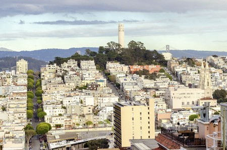 Coit Tower, aka the Lillian Coit Memorial Tower on Telegraph Hill neighborhood of San Francisco, California, United States of America. A view of the flutted white tower from Lombard street.
