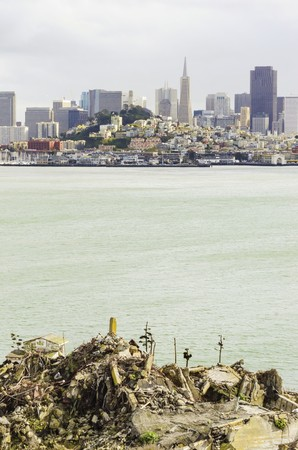 The San Francisco skyline in California, United states of America from Alcatraz island. A view of the cityscape, the skyscrapers, architecture, fishermans wharf and piers, Transamerica pyramid and coit tower. photo
