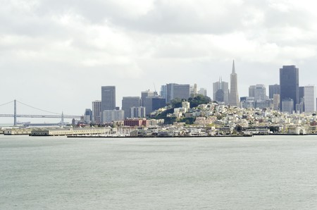 The San Francisco skyline in California, United states of America from Alcatraz island. A view of the cityscape, the skyscrapers, architecture, fishermans wharf and piers Transamerica pyramid and Bay Bridge. photo