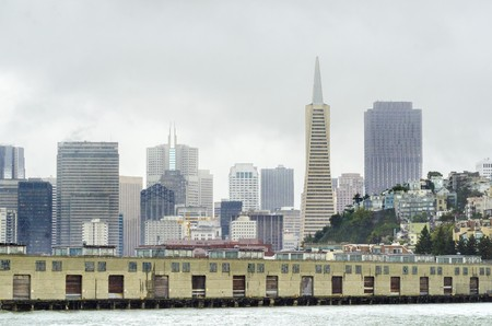 transamerica: The San Francisco skyline in California, United states of America from pier 33. A view of the cityscape, the skyscrapers, architecture, fishermans wharf and piers and Transamerica pyramid.