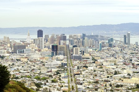 Aerial view of downtown San Francisco city skyline, California, United States of America. A view of Market street in the Castro, LGBT rainbow flag, cityscape, skyscrapers, architecture and bay from Twin Peaks. photo