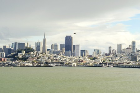 The San Francisco skyline in California, United states of America from Alcatraz island. A view of the cityscape, the skyscrapers, architecture, fishermans wharf and piers, Transamerica pyramid and coit tower.