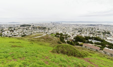 Aerial view of downtown San Francisco city skyline, California, United States of America. A panoramic view of the coast line, cityscape, skyscrapers, architecture and bay from Twin Peaks. photo