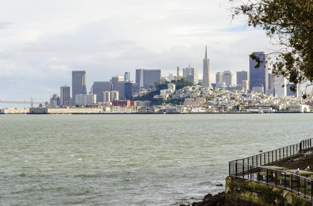 The San Francisco skyline in California, United states of America from Alcatraz island. A view of the cityscape, the skyscrapers, architecture, fishermans wharf and piers and Transamerica pyramid. photo