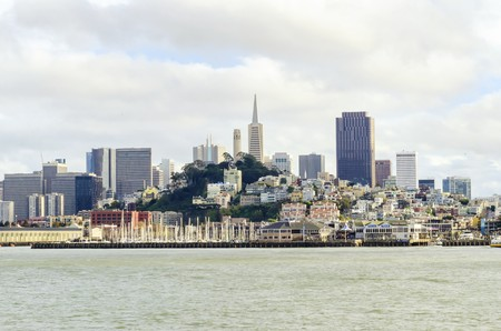The San Francisco skyline in California, United states of America from Alcatraz island. A view of the cityscape, the skyscrapers, architecture, fishermans wharf, marina and piers, Transamerica pyramid and coit tower.