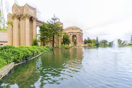 neo classical: A view of the dome rotunda of the Palace of Fine Arts in San Francisco, California, United States of America. A colonnade roman greek architecture with statues and sculptures build around a lagoon.