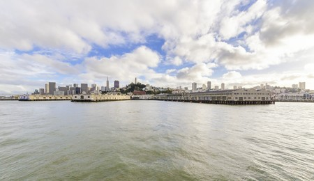 The San Francisco skyline in California, United states of America from Alcatraz island. A view of the cityscape, the skyscrapers, architecture, fishermans wharf and piers, Transamerica pyramid and Coit tower photo