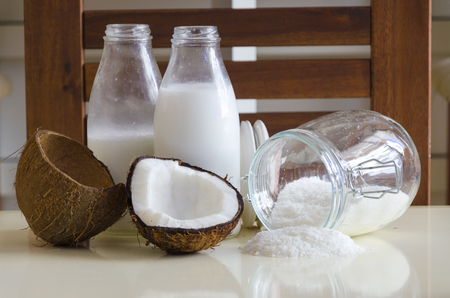 shredded coconut: Coconut products fresh milk in glass bottles on a table